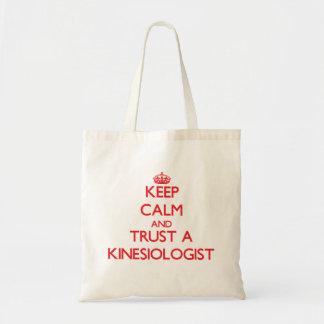 Keep Calm and Trust a Kinesiologist Canvas Bags