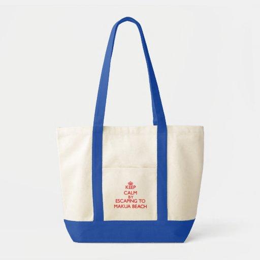 Keep calm by escaping to Makua Beach Hawaii Tote Bags