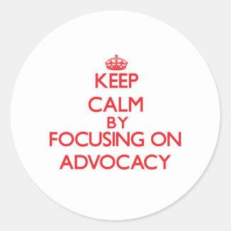 Keep Calm by focusing on Advocacy Round Sticker