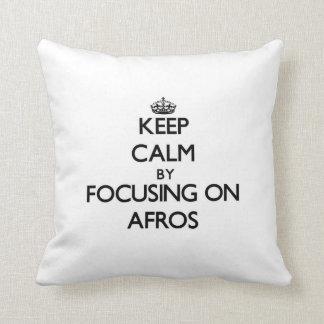 Keep Calm by focusing on Afros Throw Pillows