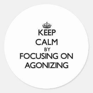 Keep Calm by focusing on Agonizing Round Sticker