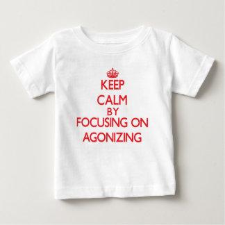 Keep Calm by focusing on Agonizing Tshirts