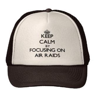 Keep Calm by focusing on Air Raids Trucker Hat