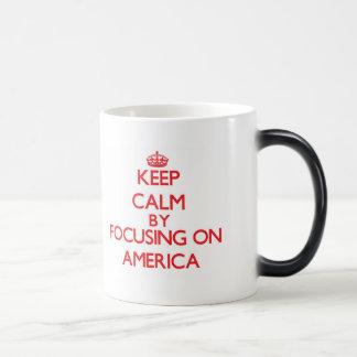 Keep Calm by focusing on America Coffee Mugs