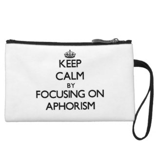 Keep Calm by focusing on Aphorism Wristlet Clutches
