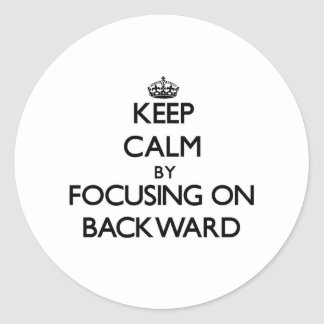 Keep Calm by focusing on Backward Round Sticker