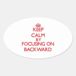 Keep Calm by focusing on Backward Sticker