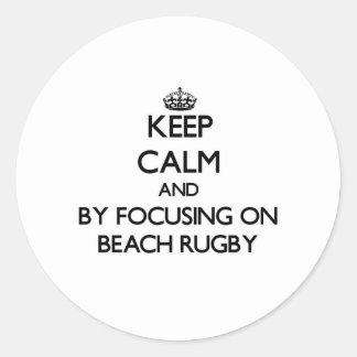 Keep calm by focusing on Beach Rugby Sticker