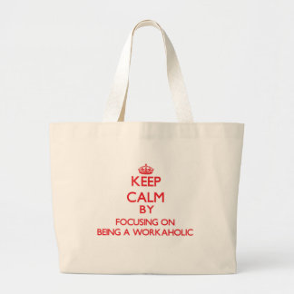 Keep Calm by focusing on Being A Workaholic Canvas Bags