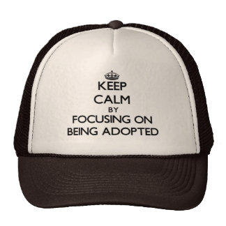 Keep Calm by focusing on Being Adopted Trucker Hat
