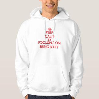 Keep Calm by focusing on Being Beefy Hoodie