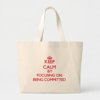 Keep Calm by focusing on Being Committed Tote Bags