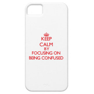 Keep Calm by focusing on Being Confused iPhone 5/5S Covers