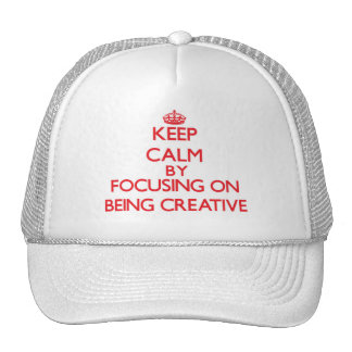 Keep Calm by focusing on Being Creative Trucker Hat
