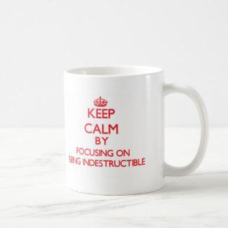 Keep Calm by focusing on Being Indestructible Basic White Mug