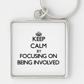 Keep Calm by focusing on Being Involved Key Chains