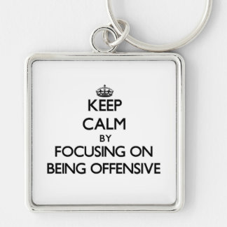 Keep Calm by focusing on Being Offensive Keychain
