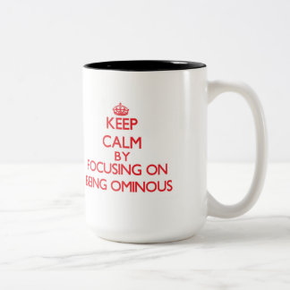 Keep Calm by focusing on Being Ominous Two-Tone Mug