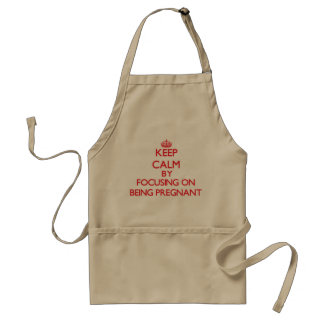 Keep Calm by focusing on Being Pregnant Aprons