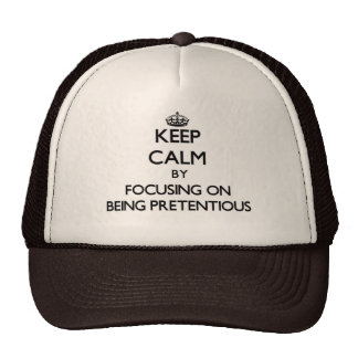 Keep Calm by focusing on Being Pretentious Trucker Hat