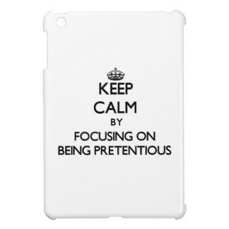 Keep Calm by focusing on Being Pretentious iPad Mini Cases