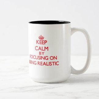 Keep Calm by focusing on Being Realistic Coffee Mug
