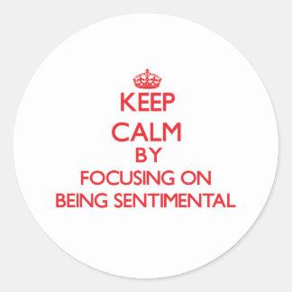 Keep Calm by focusing on Being Sentimental Round Sticker