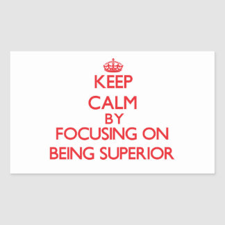 Keep Calm by focusing on Being Superior Rectangular Stickers