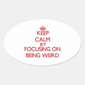 Keep Calm by focusing on Being Weird Oval Sticker