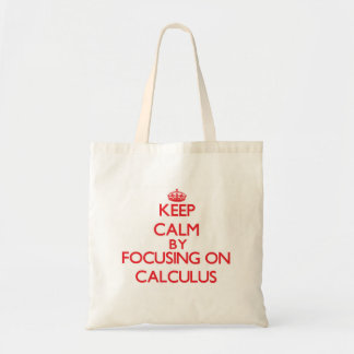 Keep Calm by focusing on Calculus Tote Bags