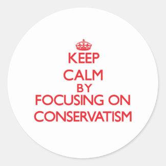 Keep Calm by focusing on Conservatism Round Sticker