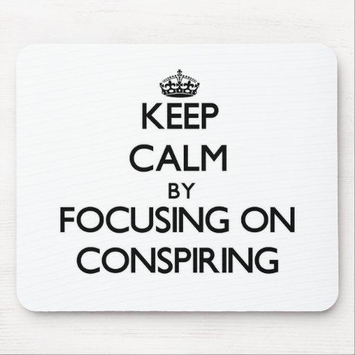 Keep Calm by focusing on Conspiring Mousepads