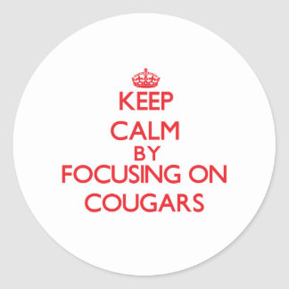Keep Calm by focusing on Cougars Sticker