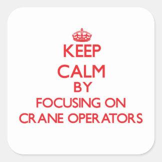 Keep Calm by focusing on Crane Operators Square Sticker