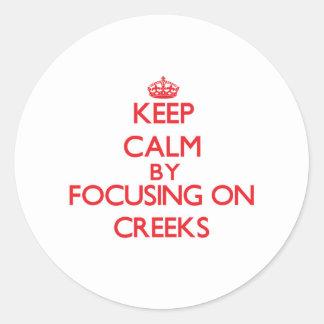 Keep Calm by focusing on Creeks Round Sticker