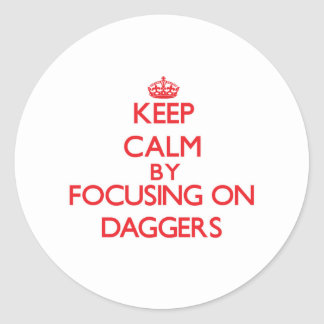Keep Calm by focusing on Daggers Round Stickers