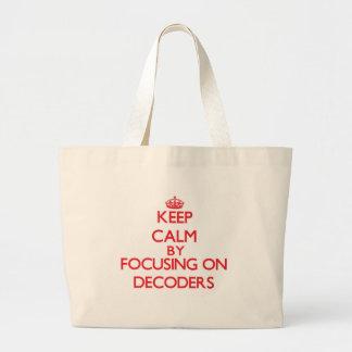 Keep Calm by focusing on Decoders Tote Bags