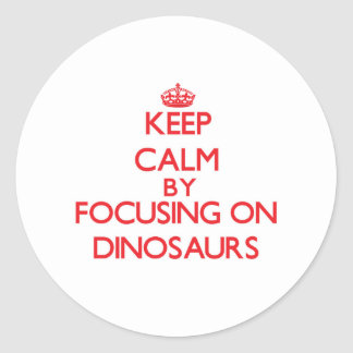 Keep Calm by focusing on Dinosaurs Sticker