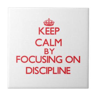 Keep Calm by focusing on Discipline Ceramic Tile