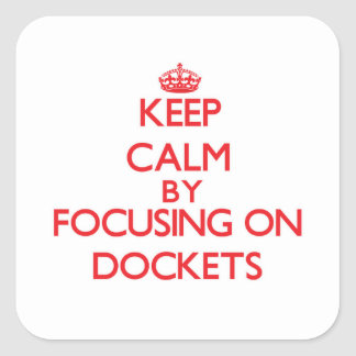 Keep Calm by focusing on Dockets Square Stickers