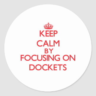 Keep Calm by focusing on Dockets Stickers