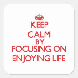 Keep Calm by focusing on ENJOYING LIFE Square Sticker