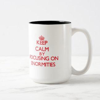 Keep Calm by focusing on ENORMITIES Mug