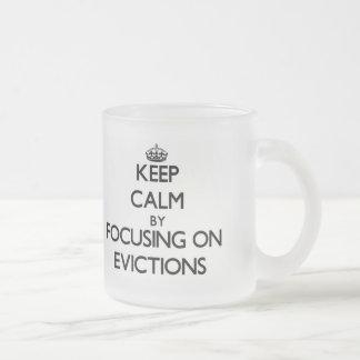 Keep Calm by focusing on EVICTIONS Coffee Mugs