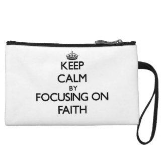Keep Calm by focusing on Faith Wristlet Clutch