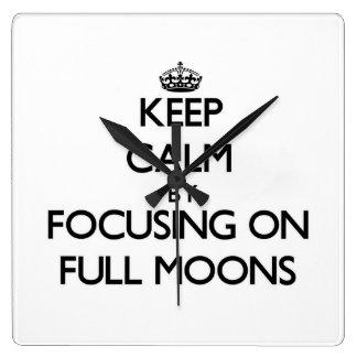 Keep Calm by focusing on Full Moons Wall Clocks