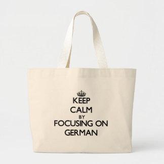 Keep calm by focusing on German Tote Bag
