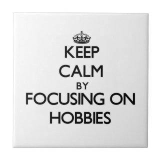 Keep Calm by focusing on Hobbies Tile