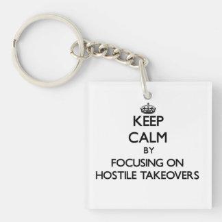 Keep Calm by focusing on Hostile Takeovers Acrylic Keychain