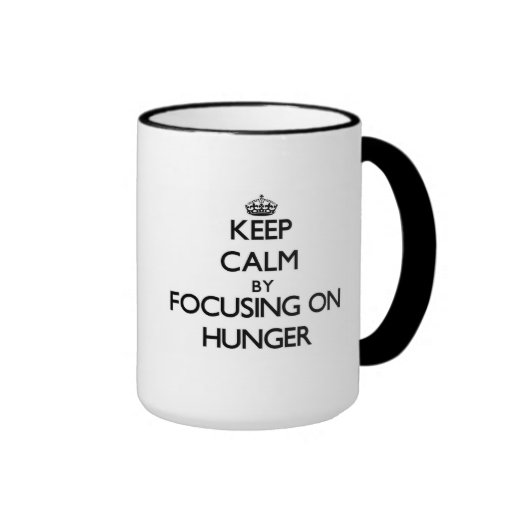 Keep Calm by focusing on Hunger Coffee Mug